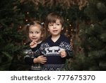 a little child by the new year...   Shutterstock . vector #777675370