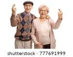 elderly couple holding their... | Shutterstock . vector #777691999