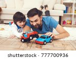 father has fun with his son. an ... | Shutterstock . vector #777700936