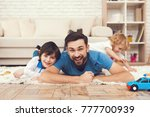 father has fun with his son. an ... | Shutterstock . vector #777700939