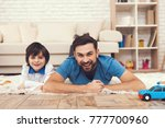 father has fun with his son. an ... | Shutterstock . vector #777700960