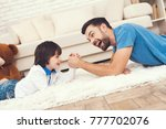 father has fun with his son. an ... | Shutterstock . vector #777702076