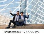 asian two businessman happy...   Shutterstock . vector #777702493