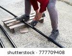 man is cutting black metal... | Shutterstock . vector #777709408
