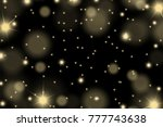 abstract shiny yellow sparkles... | Shutterstock .eps vector #777743638