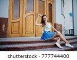 curly stylish girl wear on blue ... | Shutterstock . vector #777744400