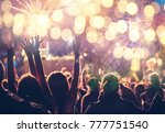 cheering crowd watching... | Shutterstock . vector #777751540