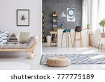 poster on the wall above grey... | Shutterstock . vector #777775189