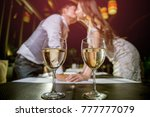 two glasses of wine place on... | Shutterstock . vector #777777079
