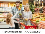 happy young family standing...   Shutterstock . vector #777788659
