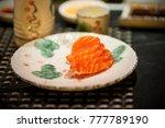 a dish of salmon sashimi | Shutterstock . vector #777789190