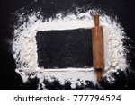 rolling pin and white flour on... | Shutterstock . vector #777794524