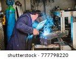strong professional welder is... | Shutterstock . vector #777798220