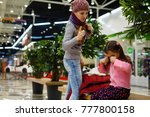 little girl cries and mother... | Shutterstock . vector #777800158