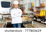positive seller in his grocery... | Shutterstock . vector #777803629