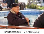 An Old Man Is Sitting In His...