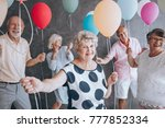 smiling grandmother wearing a... | Shutterstock . vector #777852334