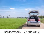 luggage on the car is traveling. | Shutterstock . vector #777859819
