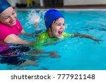 little boy learning to swim | Shutterstock . vector #777921148