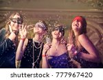 girls at a masked party  | Shutterstock . vector #777967420