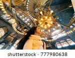 a girl under a chandelier in... | Shutterstock . vector #777980638