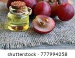grape seed oil in a glass jar... | Shutterstock . vector #777994258