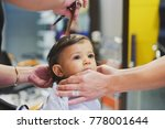 young baby boy at hairdresser... | Shutterstock . vector #778001644