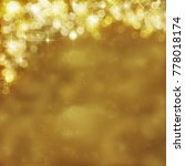 Small photo of Gold festive background. Abstract golden light, radiance with bokeh
