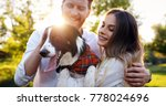 Stock photo romantic happy couple in love enjoying their time with pets 778024696