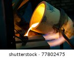 Molten Gold Being Poured Into...