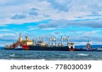 large cargo ship in the strait... | Shutterstock . vector #778030039