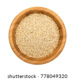 quinoa seeds in a wooden bowl... | Shutterstock . vector #778049320