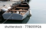 A Wooden Row Boat Is Tied Up To ...