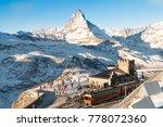 Skiers and snowboarder were preparing to ski at Gornergrat bahn train station with matterhorn peak view at the background of ski track.