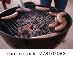 cooking sausages on grill | Shutterstock . vector #778102063