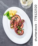 grilled octopus on white plate... | Shutterstock . vector #778122520