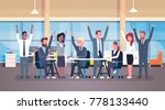cheerful business team sitting... | Shutterstock .eps vector #778133440