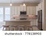 a beautiful coastal kitchen...   Shutterstock . vector #778138903