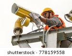 a male technician doing... | Shutterstock . vector #778159558