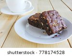 chocolate brownie and hot black ... | Shutterstock . vector #778174528