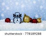 clock in a santa hat and balls... | Shutterstock . vector #778189288
