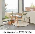 wood tea table in the balcony | Shutterstock . vector #778224964