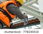a male technician is doing... | Shutterstock . vector #778230310