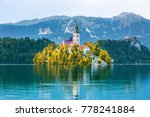 Small photo of Sunrise view On Bled Lake, Island,Church And Castle With Mountain Range (Stol, Vrtaca, Begunjscica) In The Background-Bled, Slovenia, Europe