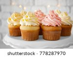 tasty cupcakes on stand | Shutterstock . vector #778287970