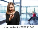 angry young pretty woman with... | Shutterstock . vector #778291648