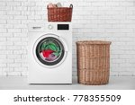 Stock photo laundry in washing machine indoors 778355509