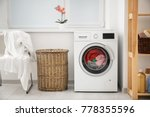 Stock photo laundry in washing machine and basket indoors 778355596