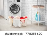 basket with laundry and washing ... | Shutterstock . vector #778355620