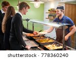 teenage students being served...   Shutterstock . vector #778360240
